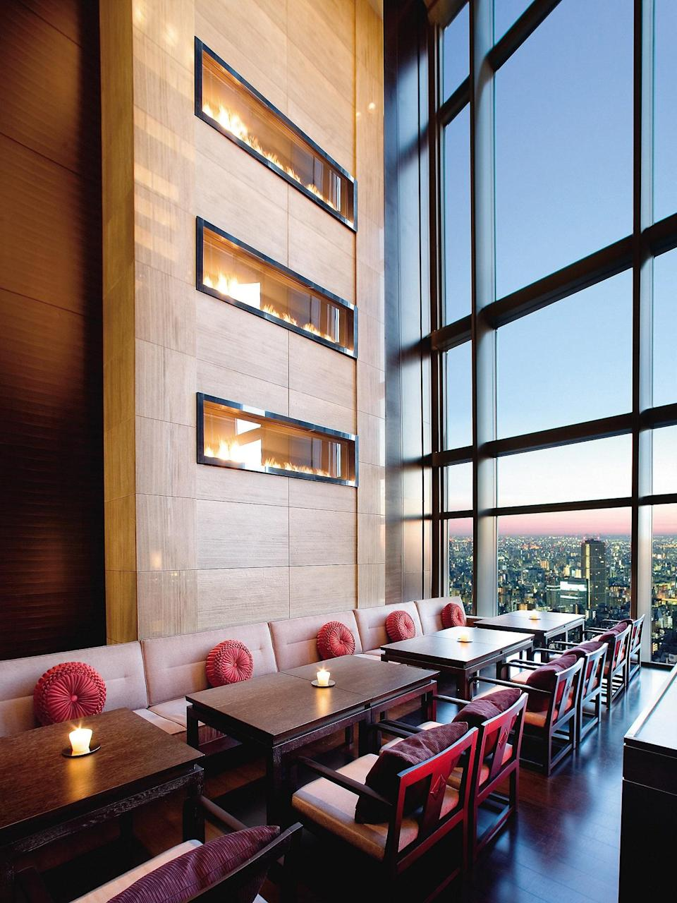 """<p><strong>How did it strike you on arrival?</strong><br> Photos don't do it justice. Rising to the upper floors of the Nihonbashi Mitsui Tower, the 37th-floor lobby is like a gallery to Tokyo's best angles. The lobby overlooks a massive, multi-story space in two directions—the check-in desk is backdropped by a western outlook through floor-to-ceiling windows, while the opposite frames Tokyo's eastern sprawl. You'll be floored, in more ways than one.</p> <p><strong>Nice. What's the crowd like?</strong><br> It's a mature, all-discerning crowd that loves a tip-top spa.</p> <p><strong>The good stuff: Tell us about your room.</strong><br> No matter the category, the view is paramount. The Mandarin Grand Rooms perch between the 30th and 36th floors like a tranquil retreat in the sky; the frenetic financial district eases down below and, on cloudless days, Mount Fuji glistens in the distance. Interiors are massive, and rooms feel bigger than most suites, all outfitted in a neutral palette; light and clean-lined wooden bedside tables are built into the wall, as is a headboard that's framed with hanging paper pendant lamps.</p> <p><strong>We're craving some deep, restorative sleep. They got us?</strong><br> Beds are as supple as the sheets are slippery. And if you can't find a perfect pillow on the extensive """"pillow menu,"""" it's not the pillow—it's you.</p> <p><strong>How about the little things, like mini bar, or shower goodies. Any of that find its way into your suitcase?</strong><br> There's a good reason that rooms come with binoculars because there is almost too much action to scope.</p> <p><strong>Please tell us the bathroom won't let us down.</strong><br> A glass wall, a backdrop to the vanity, can be closed off with interior blinds at the push of a button. There's a walk-in shower, a separate tub, and a room for the toilet. Nozzles are designed with amber-like handles to warm up the granite surfaces, and the Bottega Veneta products, without question, are worth pocket"""