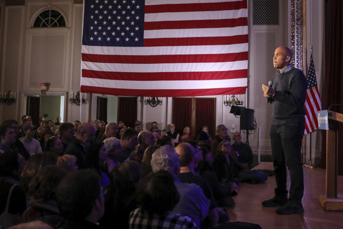 CORRECTS TO SATURDAY, NOT SUNDAY-U.S. Sen. Cory Booker, D-N.J., pauses while sharing a personal story while speaking at a post-midterm election victory celebration in Manchester, N.H., on Saturday, Dec. 8, 2018. (AP Photo/Cheryl Senter)