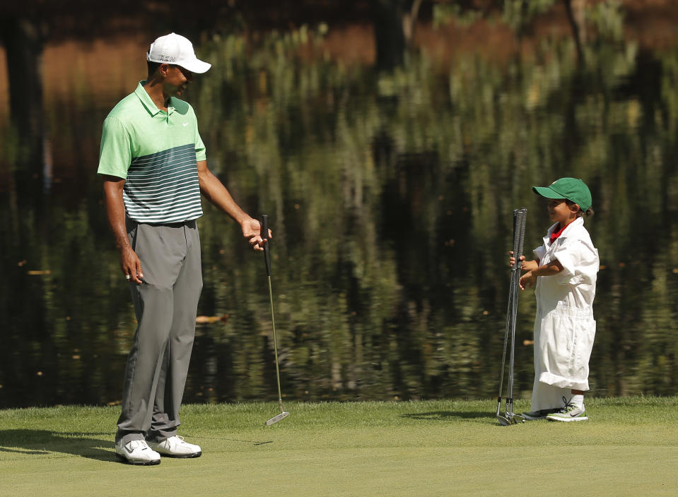 Tiger Woods smiles at his son Charlie at the Augusta National Golf Course.