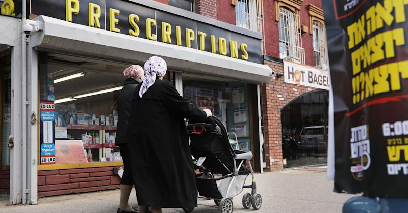 People walk through an ultra-Orthodox Jewish community in Williamsburg on April 10, 2019 in New York City.