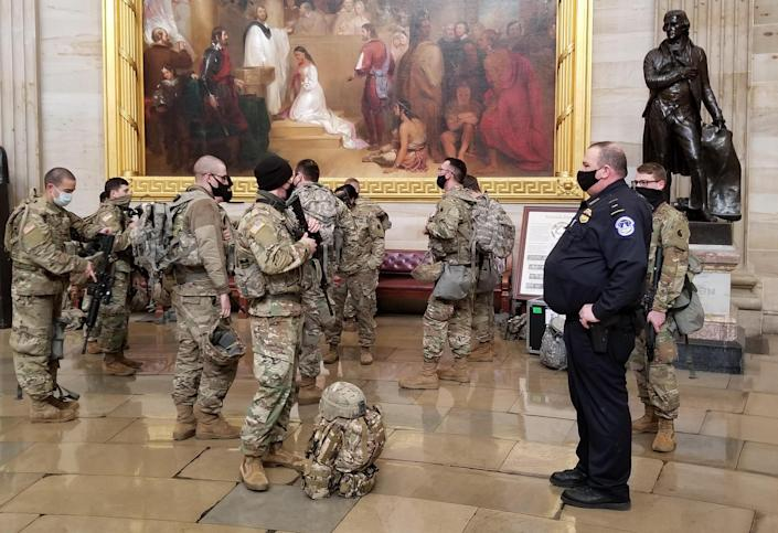 National Guard troops in the U.S. Capitol Rotunda on January 13, 2021. / Credit: Grace Segers / CBS News