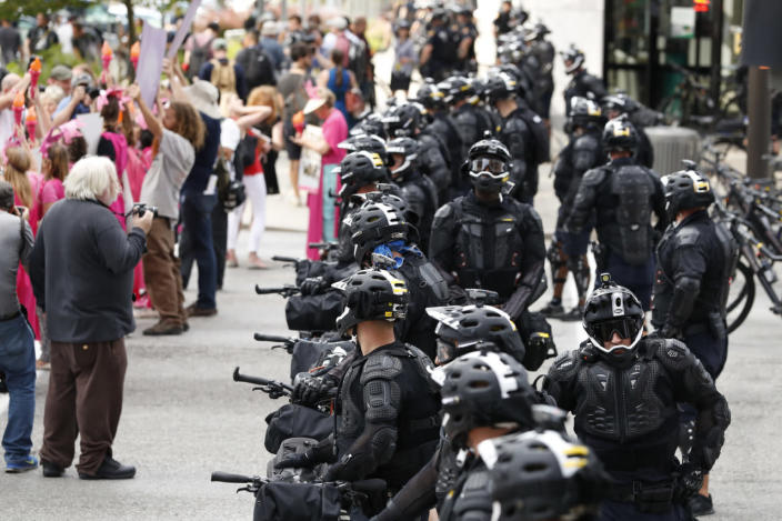 <p>Demonstrators march by police during the Shut Down Trump & the RNC protest on July 17, 2016, in Cleveland, Ohio. (Photo: Alex Brandon/AP)</p>