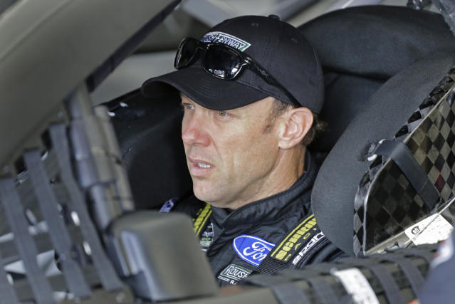 "<a class=""link rapid-noclick-resp"" href=""/nascar/sprint/drivers/81/"" data-ylk=""slk:Matt Kenseth"">Matt Kenseth</a> waits in his car before practice for Saturday's NASCAR All-Star auto race at Charlotte Motor Speedway in Concord, N.C., Saturday, May 19, 2018. (AP Photo/Terry Renna)"