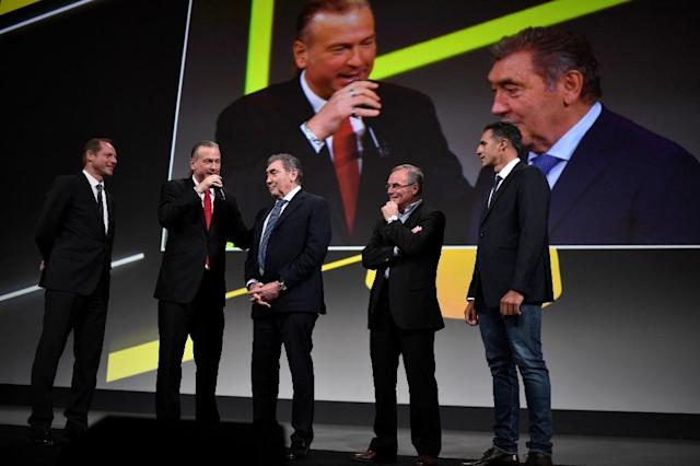 Tour de France director Christian Prudhomme (L), five-time winners Eddy Merckx of Belgium (C), Bernard Hinault of France (2R) and Miguel Indurain of Spain (R) at the unveiling of the 2019 route in Paris. (AFP Photo/STEPHANE DE SAKUTIN)