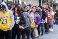 A long line of fans wearing Kobe and Los Angeles Lakers jerseys and memorabilia wrapped around the venue.