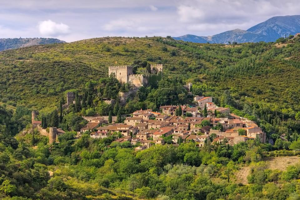 """<p><strong>Population:</strong> 328</p> <p>The medieval village of Castelnou is so well preserved, you might think you've traveled back in time as you walk along the narrow streets. The town's eponymous castle sits high on a hill and overlooks the stone houses below, all set to the backdrop of the gorgeous Pyrenees. For an extra dose of charm, plan your visit around Castelnou's annual <a href=""""https://www.cntraveler.com/gallery/best-christmas-markets-in-europe?mbid=synd_yahoo_rss"""" rel=""""nofollow noopener"""" target=""""_blank"""" data-ylk=""""slk:Christmas market"""" class=""""link rapid-noclick-resp"""">Christmas market</a> in December.</p>"""