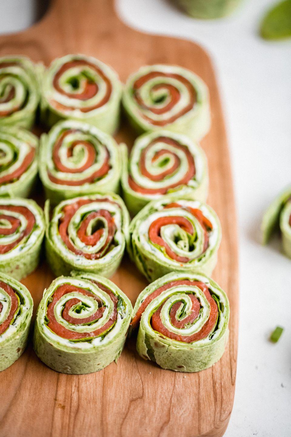 "<p>To add some variety to the app feast, try these smoked salmon pinwheels that are both tasty and super quick to make.</p><p><strong>Get the recipe at <a href=""https://www.ambitiouskitchen.com/smoked-salmon-pinwheels/"" rel=""nofollow noopener"" target=""_blank"" data-ylk=""slk:Ambitious Kitchen"" class=""link rapid-noclick-resp"">Ambitious Kitchen</a>.</strong></p><p><strong><a class=""link rapid-noclick-resp"" href=""https://www.amazon.com/Premium-Stainless-Steel-Mixing-Brushed/dp/B01HTYH8YA/r?tag=syn-yahoo-20&ascsubtag=%5Bartid%7C10050.g.2966%5Bsrc%7Cyahoo-us"" rel=""nofollow noopener"" target=""_blank"" data-ylk=""slk:SHOP MIXING BOWLS"">SHOP MIXING BOWLS</a><br></strong></p>"