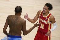 Atlanta Hawks guard Trae Young (11) congratulates Brooklyn Nets forward Kevin Durant (7) after the Nets' win in an NBA basketball game Wednesday, Jan. 27, 2021, in Atlanta. (AP Photo/Brynn Anderson)