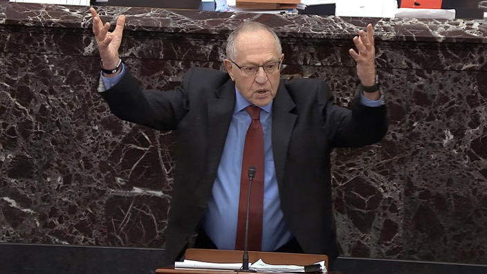 Alan Dershowitz, an attorney for President Trump, answers a question during the impeachment trial on Wednesday. (Senate Television via AP)