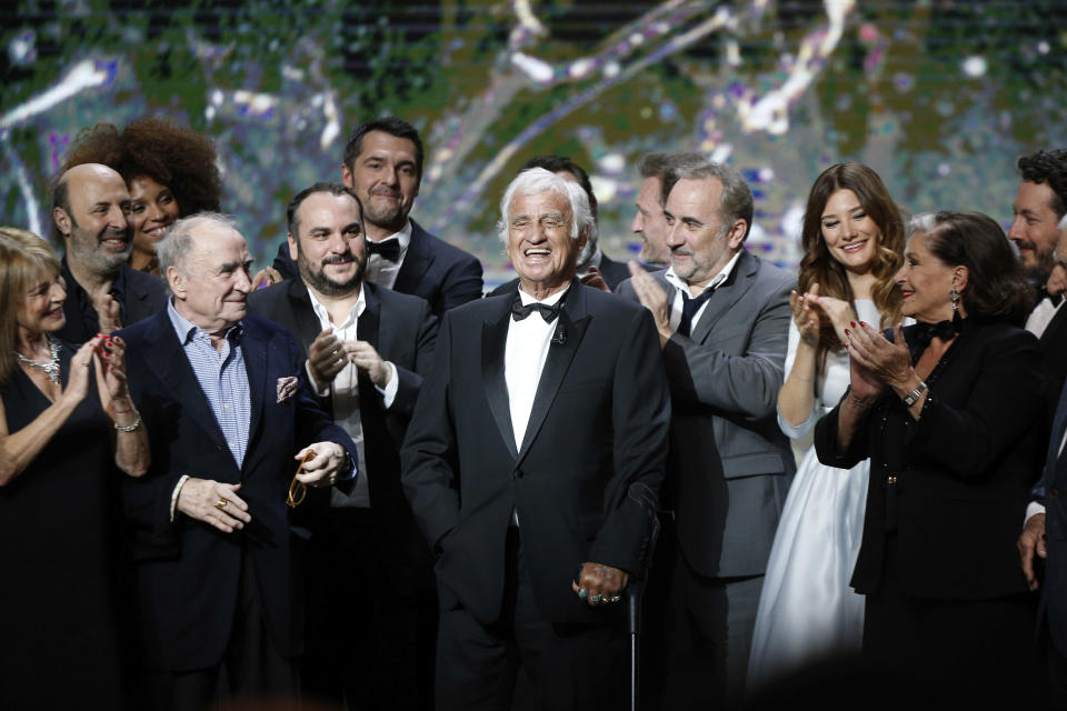 FILE - In this Feb. 24, 2017 file photo, French actor Jean-Paul Belmondo, center, is congratulated by actors on stage during the ceremony of the 42nd Cesar Film Awards, at the Salle Pleyel, in Paris. French New Wave actor Jean-Paul Belmondo has died, according to his lawyer's office on Monday Sept. 6, 2021. (AP Photo/Thibault Camus, File)