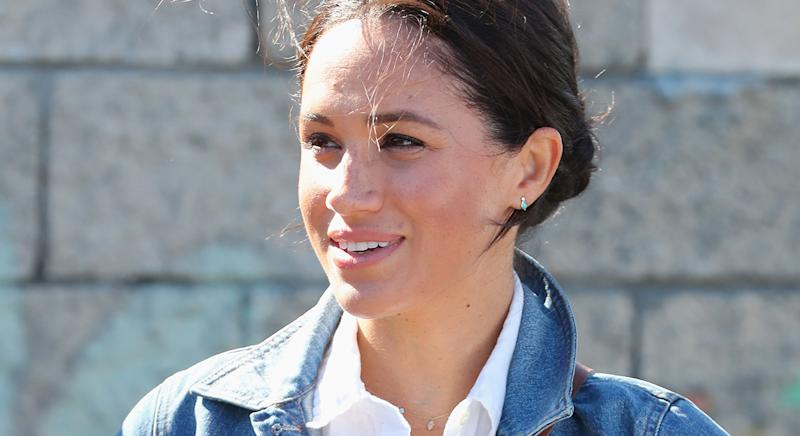 Meghan, pictured here on September 24, 2019 in Cape Town, and Harry marked the anniversary of Princess Diana's death by planting flowers with school children. (Getty Images)