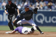 San Diego Padres second baseman Luis Urias waits for the throw before tagging out Colorado Rockies' Daniel Murphy at second during the second inning of a baseball game Sunday, Sept. 8, 2019, in San Diego. (AP Photo/Gregory Bull)