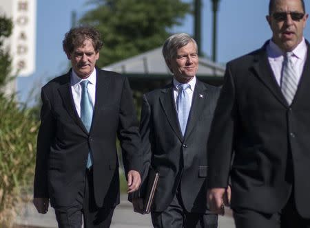 Former Virginia Governor Robert McDonnell arrives with his legal team for his trial in Richmond