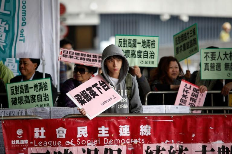 Protesters outside the Legislative Council before Hong Kong's Chief Executive Leung Chun-ying delivers his 2016 policy address in Hong Kong on January 13, 2016