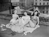 <p>We all have that *one* friend who has <em>the</em> killer rooftop for summertime hangs, just like actress Audrey Hepburn (middle) and her friends. </p>