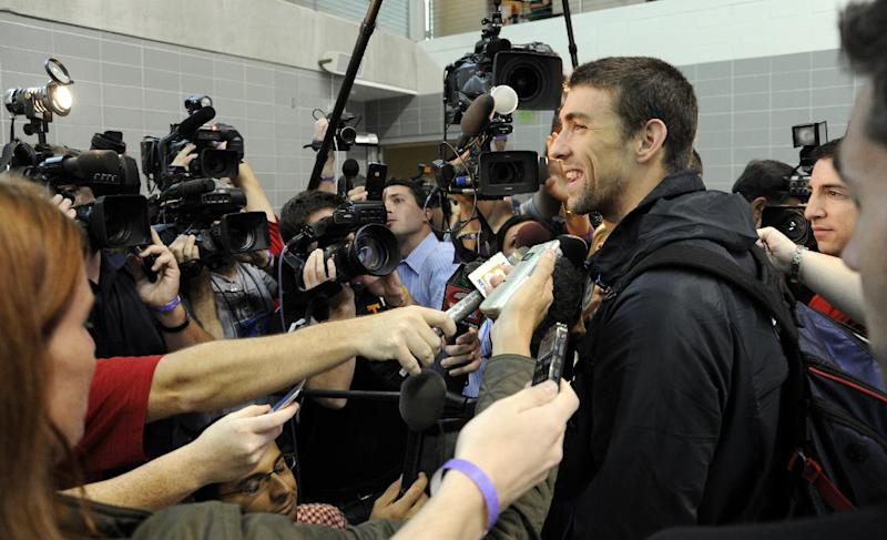 U.S. Olympic swim team member Michael Phelps is interviewed by the media after practice at the University of Tennessee's Allan Jones Aquatic Center, Thursday, July, 12, 2012, in Knoxville, Tenn. (AP Photo/Knoxville News Sentinel, Michael Patrick)