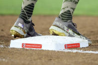 Philadelphia Phillies' Rhys Hoskins stands on first base Friday, May 14, 2021, while wearing cleats in honor of Armed Forces Day, which is Saturday, during the fourth inning of the team's baseball game against the Toronto Blue Jays in Dunedin, Fla. (AP Photo/Mike Carlson)