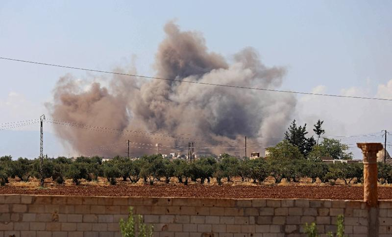 Smoke billows following a bombardment by Syrian government forces around the town of Khan Sheikhun on the southern edges of the rebel-held Idlib province on September 8, 2018 (AFP Photo/OMAR HAJ KADOUR)