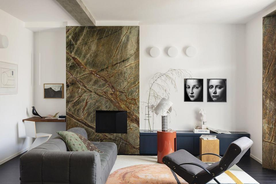 """<p>Tucked to one side of a green-marble fireplace, this simple shelf of a desk is a minimal but functional option. The brainchild of Milanese design studio Concepta, it ensures the decorative details in this room – photographs by Simone Schiesari and a rug by Faye Toogood for CC-Tapis – shine. <a href=""""https://concepta.it/"""" rel=""""nofollow noopener"""" target=""""_blank"""" data-ylk=""""slk:concepta.it"""" class=""""link rapid-noclick-resp"""">concepta.it</a></p>"""