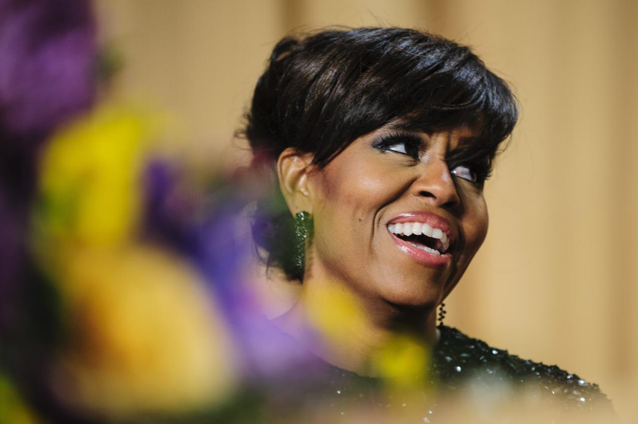 WASHINGTON, DC - APRIL 27:  First lady Michelle Obama reacts to a joke told by comedian Conan O'Brien during the White House Correspondents' Association Dinner on April 27, 2013 in Washington, DC. The dinner is an annual event attended by journalists, politicians and celebrities. (Photo by Pete Marovich-Pool/Getty Images)