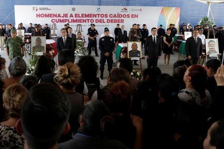 Relatives of a police officer, who was killed along other fellow police officers during an ambush by suspected cartel hitmen, attend an homage organised by the state government, in Morelia