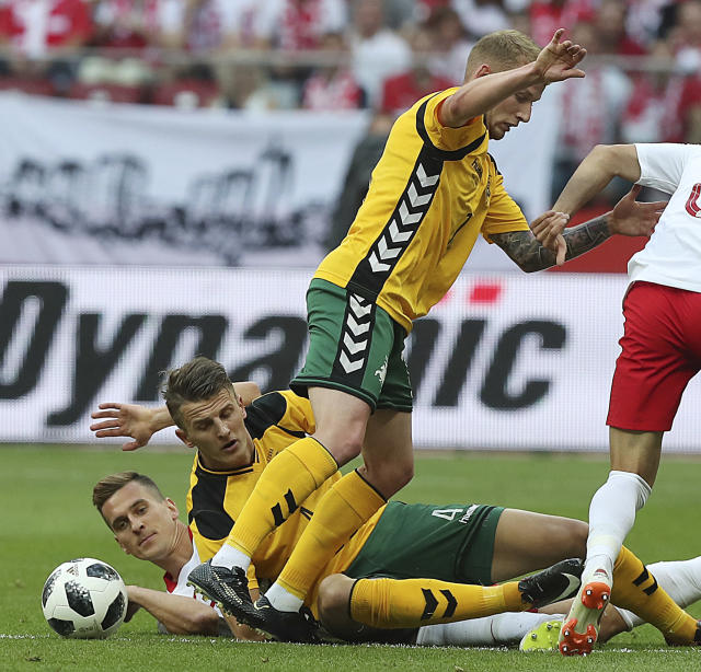 Poland's Arkadiusz Milik,left, is challenged by Lithuania's Modestas Vorobiovas,right, during a friendly soccer match between Poland and Lithuaniain Warsaw, Poland, Tuesday, June 12, 2018. (AP Photo/Czarek Sokolowski)