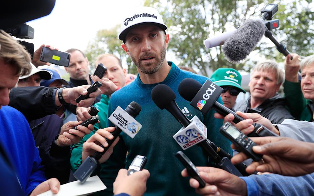 Dustin Johnson of the US speaks with the media outside the clubhouse - Credit: EPA