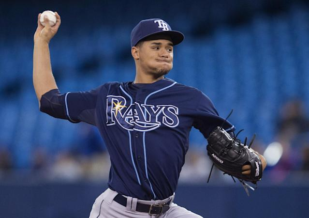 Tampa Bay Rays starting pitcher Chris Archer works against the Toronto Blue Jays during the first inning of a baseball game in Toronto on Wednesday, May 28, 2014. (AP Photo/The Canadian Press, Darren Calabrese)