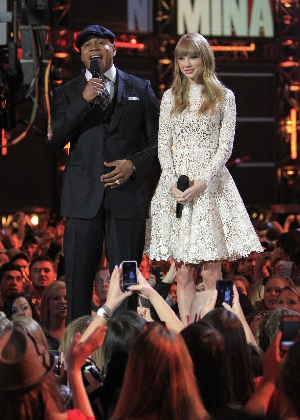 Hosts LL Cool J, left, and Taylor Swift speak onstage at the Grammy Nominations Concert Live! at Bridgestone Arena on Wednesday, Dec. 5, 2012, in Nashville, Tenn. (Photo by Wade Payne/Invision/AP)