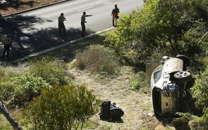 L.A. County Sheriff's officers investigate an accident involving golfer Tiger Woods along Hawthorne Blvd.