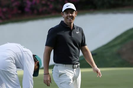 Rory McIlroy of Northern Ireland smiles after making a birdie putt on the 13th green during first round play of the 2018 Masters golf tournament at the Augusta National Golf Club in Augusta, Georgia, U.S., April 5, 2018. REUTERS/Mike Segar
