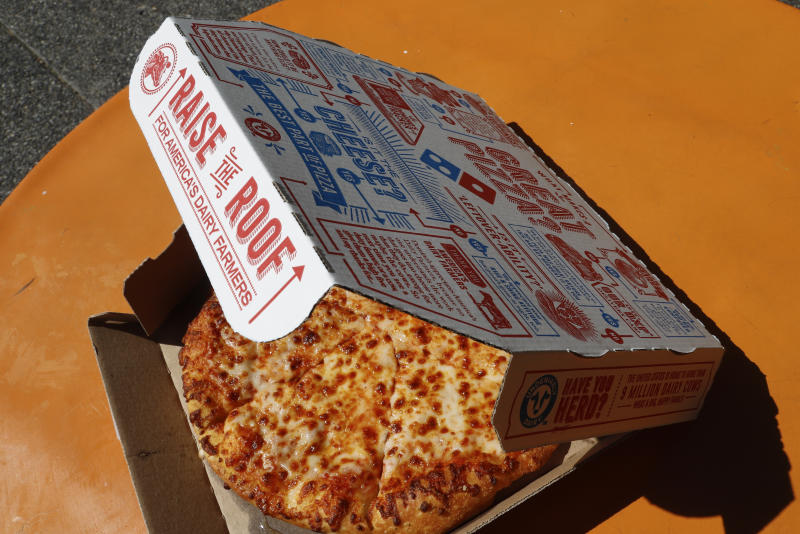 FILE - This July 15, 2019, file photo shows a small Domino's pizza made in a Domino's Pizza shop in downtown Pittsburgh. Domino's Pizza says strong carryout sales helped it achieve better-than-expected results in the fourth quarter despite increasing competition from food delivery companies like DoorDash. (AP Photo/Gene J. Puskar, File)