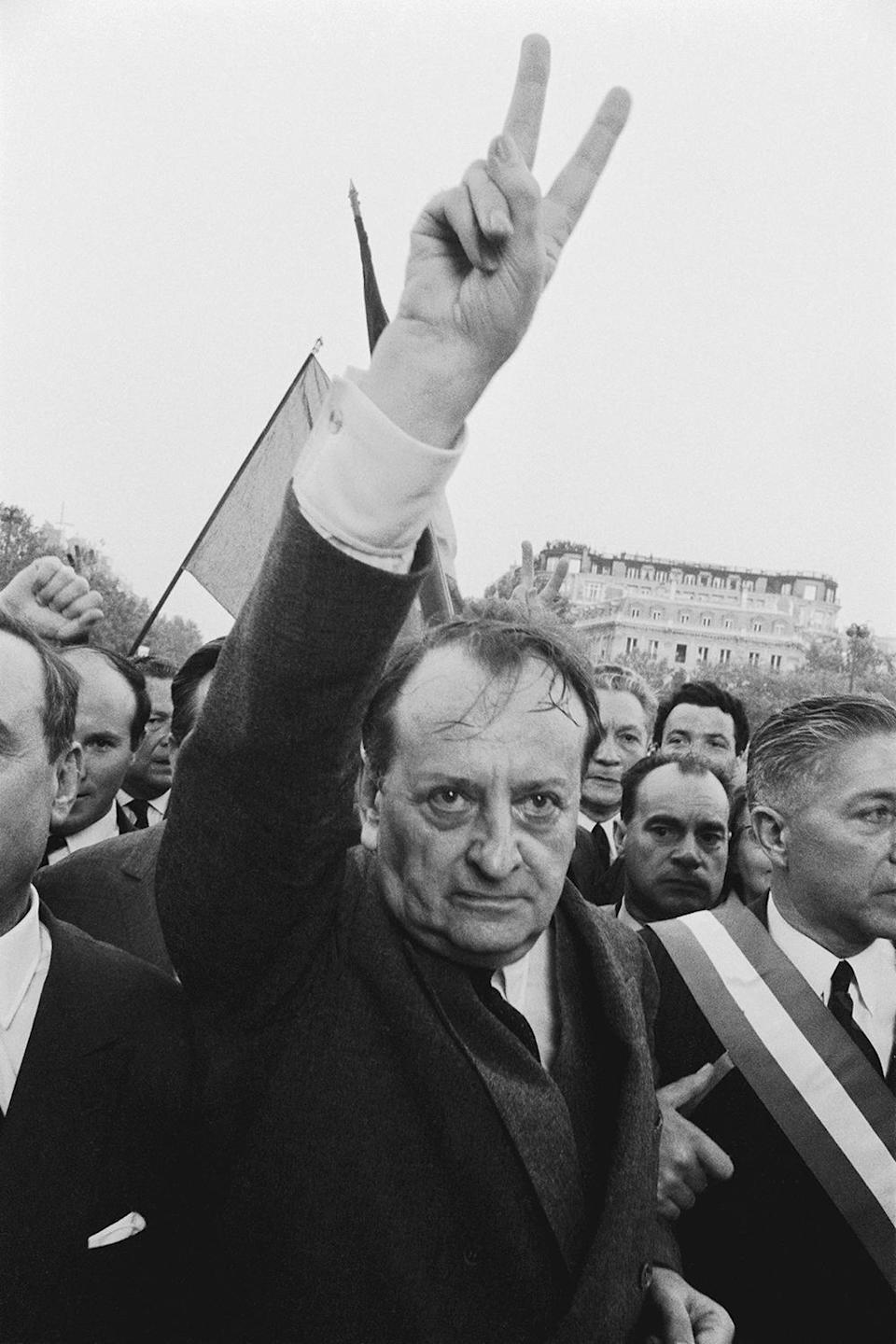"""<p>Andre Malraux and other Gaullists rally to President Charles de Gaulle's call in a radio speech for the """"silent majority"""" to demonstrate against the rioting students and workers. They led more than a half-million supporters to the Arc de Triomphe, where the Gaullist leaders placed a symbolic wreath at the Tomb of the Unknown Soldier in Paris, May 30, 1968. (Photo: Gökşin Sipahioğlu/SIPA) </p>"""