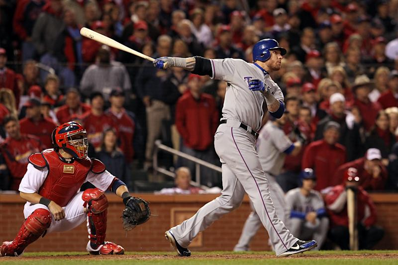 ST LOUIS, MO - OCTOBER 27: Josh Hamilton #32 of the Texas Rangers hits a two-run home run in the 10th inning during Game Six of the MLB World Series against the St. Louis Cardinals at Busch Stadium on October 27, 2011 in St Louis, Missouri. (Photo by Jamie Squire/Getty Images)