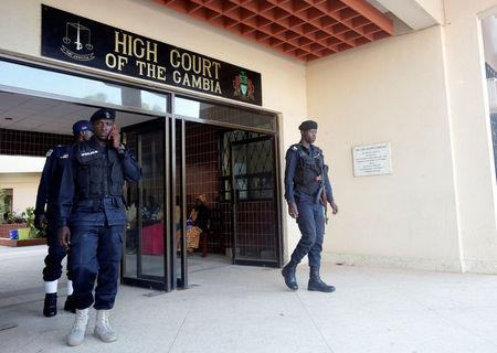 Security forces are seen as they stand next to the entrance of the Gambian high court in Banjul, Gambia December 5, 2016. REUTERS/Thierry Gouegnon