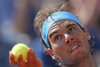 Spain's Rafael Nadal serves his the third round match of the French Open tennis tournament to win in three sets 6-1, 6-3, 6-2, against Russia's Andrey Kuznetsov at the Roland Garros stadium, in Paris, France, Saturday, May 30, 2015. (AP Photo/David Vincent)