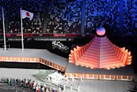 <p>An overview shows the Olympic flag being carried onto the field of play during the opening ceremony of the Tokyo 2020 Olympic Games, at the Olympic Stadium, in Tokyo, on July 23, 2021. (Photo by François-Xavier MARIT / AFP) (Photo by FRANCOIS-XAVIER MARIT/AFP via Getty Images)</p>