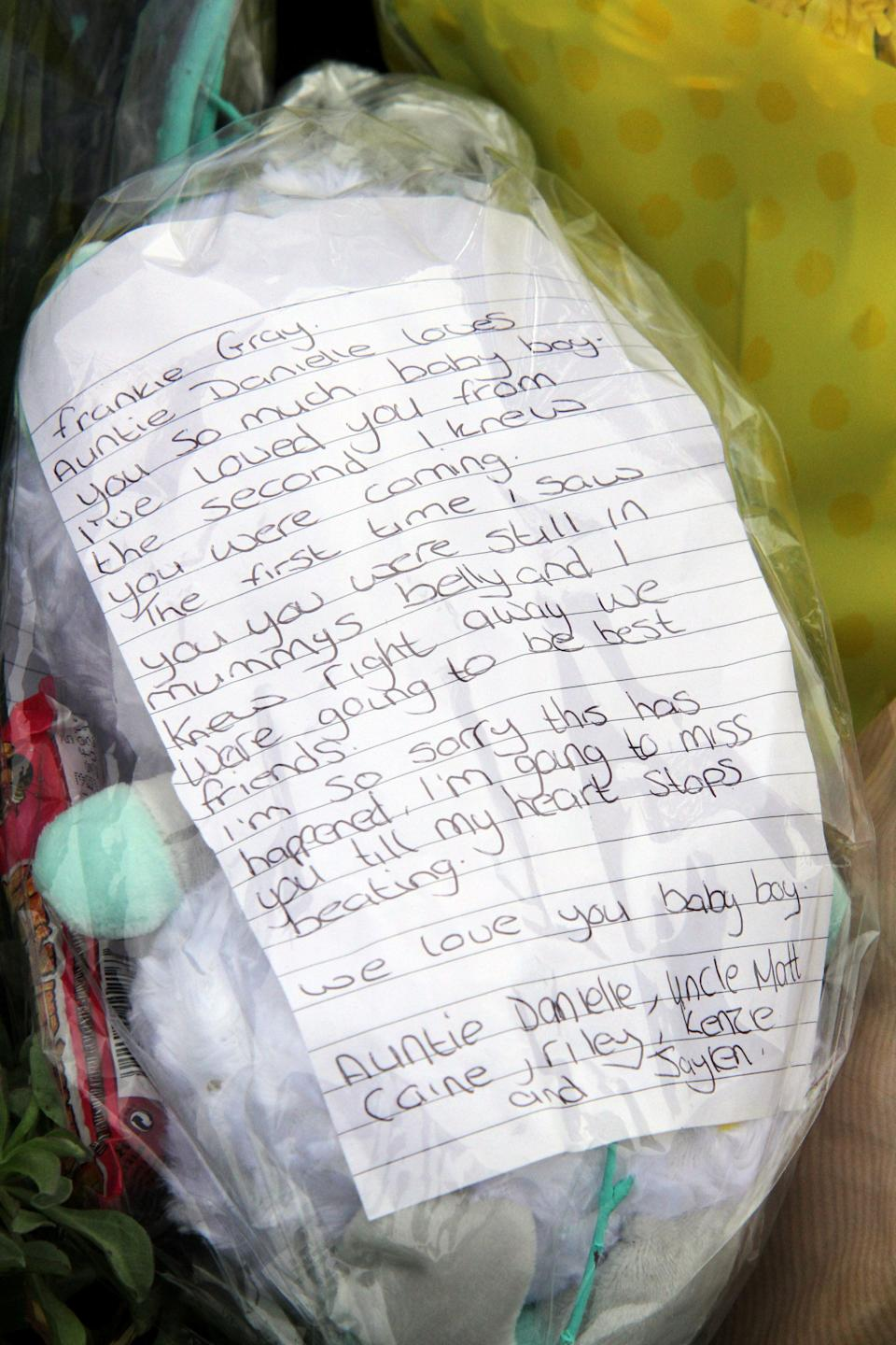 Relatives leave flowers at the entrance to Tencreek Holiday Park, Looe, Cornwall.  Frankie Macritchie was killed by a dog in the early hours of Saturday morning.