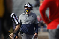 West Virginia coach Neal Brown walks down the sideline during the first half of an NCAA football game against Texas Tech, Saturday, Oct. 24, 2020, in Lubbock, Texas. (AP Photo/Brad Tollefson)