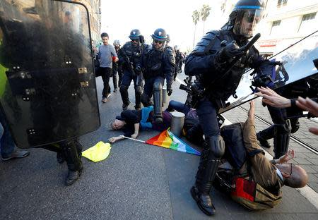 """People lay on the ground as riot police try to disperse the crowd as French """"yellow vests"""" stage their 19th round of protests in Nice, France, March 23, 2019. REUTERS/Eric Gaillard"""