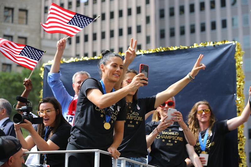 Ali Krieger takes photos of the crowds as the U.S. women's soccer team is celebrated with a parade along the Canyon of Heroes, Wednesday, July 10, 2019, in New York. (Photo: Gordon Donovan/Yahoo News)