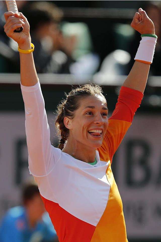 Germany's Andrea Petkovic celebrates winning her quarterfinal match of the French Open tennis tournament against Italy's Sara Errani at the Roland Garros stadium, in Paris, France, Wednesday, June 4, 2014. Petkovic won in two sets 6-2, 6-2. (AP Photo/David Vincent)