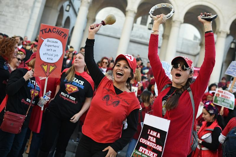 Striking teachers cheered as the teacher's union reached a tentative deal with the Los Angeles Unified School District (AFP Photo/Robyn BECK                         )