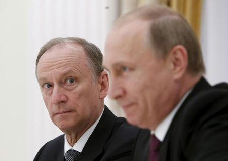 Russian Security Council Secretary Patrushev and President Putin attend a meeting with the BRICS countries' senior officials in Moscow