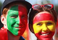 <p>Portugal's and Spain's football fans with national flags painted on their faces seen outside Fisht Stadium ahead of their 2018 FIFA World Cup Group B match. Sergei Malgavko/TASS (Photo by Sergei Malgavko\TASS via Getty Images) </p>