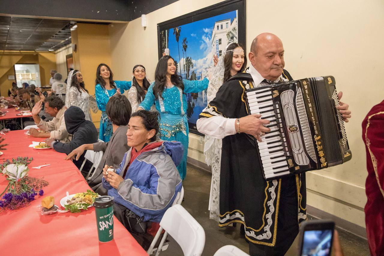 Traditional musicians and dancers entertain as Iranian-American volunteers cook and serve food for homeless and near-homeless people at Midnight Mission shelter on Skid Row to celebrate Nowruz, Iranian New Year in Los Angeles, California, U.S. March 16, 2018. REUTERS/Monica Almeida