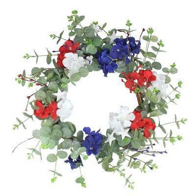 """<p><strong>Northlight</strong></p><p>target.com</p><p><strong>$43.99</strong></p><p><a href=""""https://www.target.com/p/northlight-patriotic-hydrangea-wreath-with-foliage-red-white-and-blue-20-inch/-/A-76187738"""" rel=""""nofollow noopener"""" target=""""_blank"""" data-ylk=""""slk:SHOP NOW"""" class=""""link rapid-noclick-resp"""">SHOP NOW</a></p><p>For a fresh take on Fourth of July decor, this botanical-themed wreath uses artificial eucalyptus and red, white, and blue blooms for a festive display.</p>"""