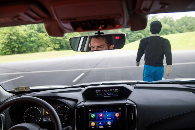 FILE PHOTO: IIHS technician Floyd demonstrates pedestrian crash prevention test on Subaru Forester at IIHS-HLDI Vehicle Research Center in Ruckersville, Virginia