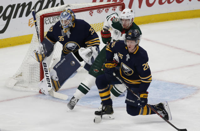 Buffalo Sabres defenseman Rasus Dahlin (26) and Minnesota Wild forward Eric Staal (12) battle in front goalie Linus Ullmark (35) during the first period of an NHL hockey game, Tuesday, Feb. 5, 2019, in Buffalo N.Y. (AP Photo/Jeffrey T. Barnes)