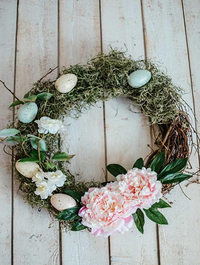 """<p>Nature is finally waking up again after a long winter. Mark that transition by making an Easter wreath that'll reflect the pops of green outside.</p><p><strong>Get the tutorial at <a href=""""https://www.hallstromhome.com/easy-easter-egg-wreath-how-to-make/"""" rel=""""nofollow noopener"""" target=""""_blank"""" data-ylk=""""slk:Hallstrom Home"""" class=""""link rapid-noclick-resp"""">Hallstrom Home</a>.</strong></p><p><a class=""""link rapid-noclick-resp"""" href=""""https://go.redirectingat.com?id=74968X1596630&url=https%3A%2F%2Fwww.walmart.com%2Fip%2FHampton-Art-18-Grapevine-Wreath%2F599352849&sref=https%3A%2F%2Fwww.thepioneerwoman.com%2Fhome-lifestyle%2Fcrafts-diy%2Fg35698457%2Fdiy-easter-wreath-ideas%2F"""" rel=""""nofollow noopener"""" target=""""_blank"""" data-ylk=""""slk:SHOP GRAPEVINE WREATHS"""">SHOP GRAPEVINE WREATHS</a></p>"""